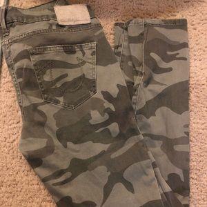 "Women's ""Casey"" True Religion camo skinny jeans."